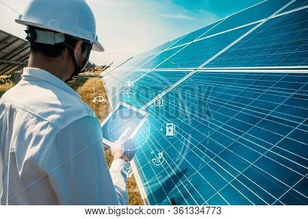 The Solar Farm(solar Panel) With Engineers Walk To Check The Operation Of The System By Laptop, Alte