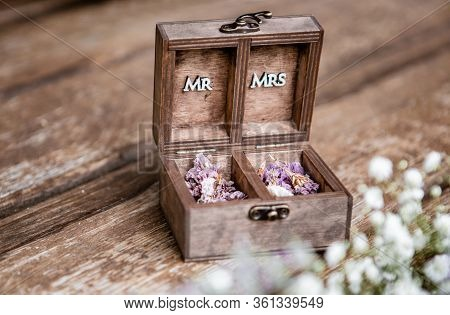 The Wooden Wedding Case With Mr. And Mrs. Word Written In The Case