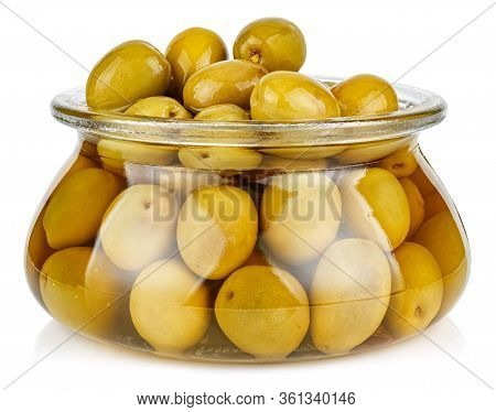 Whole Green Olives In Brine In A Open Transparent Glass Oval Storage Jar Isolated On White Backgroun