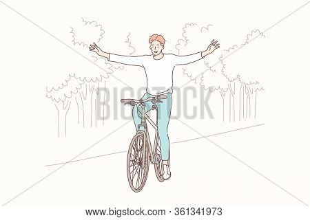 Cycling In Park, Freedom, Lifestyle Concept. Young Happy Smiling Boy Teenager Student Or Man Cyclist