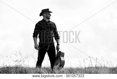 Solely Graceful. Hipster Fashion. Happy And Free. Western Camping And Hiking. Cowboy Man With Acoust