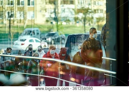 Kiev, Ukraine, 04.08.2020: A Queue Of People Wearing Medical Masks At The Entrance To Silpo Store. E