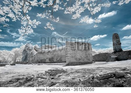 Ancient Reclining Buddha Image In Buddhist Temple In Ayutthaya, Thailand In Infrared Photography