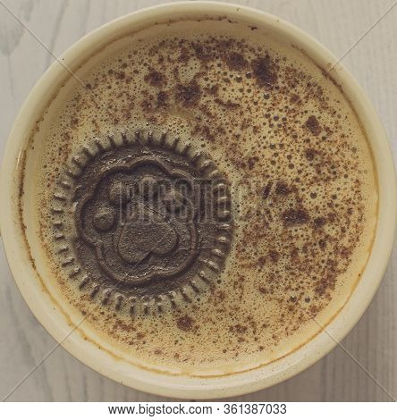 Mug Of Cappuccino With Cinnamon For Breakfast. A Cookie With A Paw Pattern Floats In A Cappuccino сu