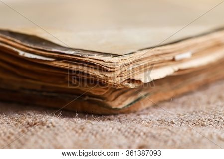An Plose Up Of Old Book On Burlap Backgroung