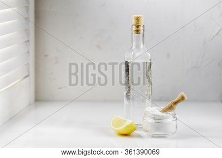 Vinegar, Baking Soda And Lemon On White Background