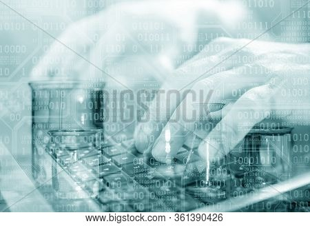 Close Up Of Scientist's Hands Working On  Laptop Computer. Laboratory Transparent Glassware Instrume