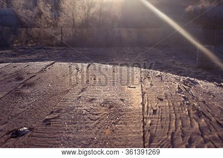 Boards Covered With Frost At Dawn. Sunlight Falls On The Boards. The Surface Of The Boards Is Covere