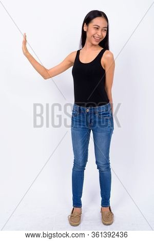 Full Body Shot Of Happy Young Asian Woman With Stop Gesture