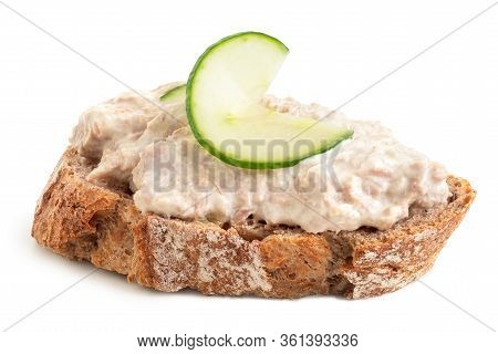 Tuna Mayonnaise With Cucumber Garnish On Wholewheat Rustic Bread Isolated On White. Low Angle.