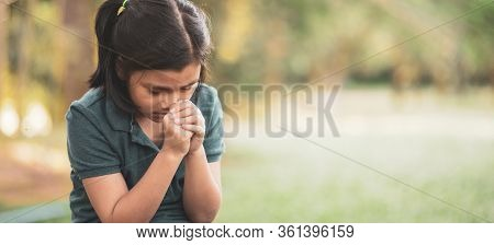 Pray Concept.asian Child Praying,hope For Peace And Free From Disease,hand In Hand Together By Kid ,