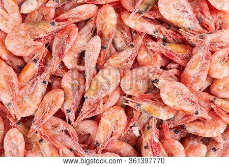Northern Deep Sea Wild Shrimp. Frozen Boiled Shrimp Without Glaze, As A Background.