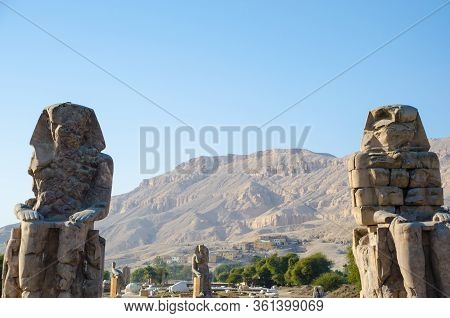 Luxor, Egypt. The Colossi Of Memnon Are Two Massive Stone Statues Of The Pharaoh Amenhotep Iii