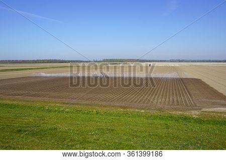 Almere, The Netherland - April 15, 2020: Lateral Moving Irrigation Sprinkler System.