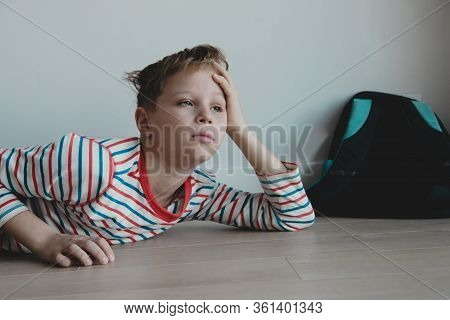 Child Tired And Bored Of Doing Homework, Kid Stressed From Learning
