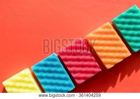 Brightly Colored Sponges On Red Background With Copy Space.cleanup Day.sponges Cleaning Kit .house C