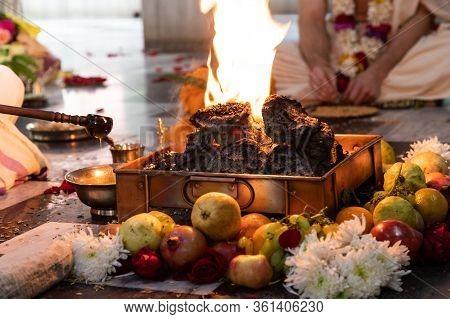 Indian Hindu Traditional Pooja. Vedic Fire Ceremony Called Yagya. Indian Wedding Of Vivah Yagya. Ite