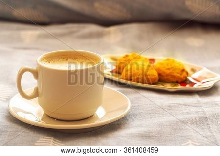 Cup Of Morning Coffee And Cookies In Bed. A Cup Of Coffee On A Saucer And Cookies On A Stand On The