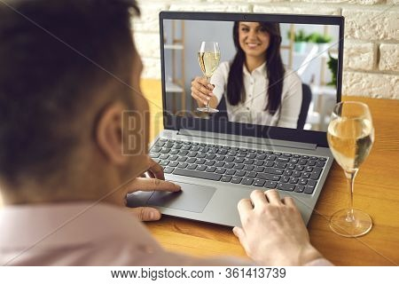 Date Online. Loving Couple With Glasses Of Wine On A Date Distance Using A Video Call Laptop In A Ro