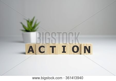 Action Word Written On Wood Block. Action Text On Table, Concept.