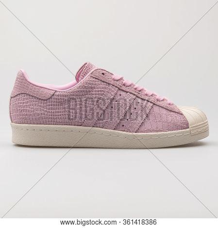 Vienna, Austria - August 24, 2017: Adidas Superstar Pink Sneaker On White Background.