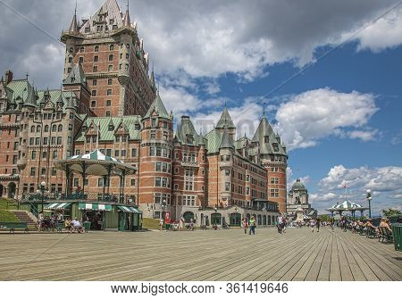 Quebec City, Quebec, Canada, July 2012 - Le Chateau Frontenac Towering Over The Boardwalk And Parks