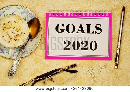 Goals 2020-writing Text On A Notepad. Long-term Vision Of Future Actions, Development Of A Method Fo