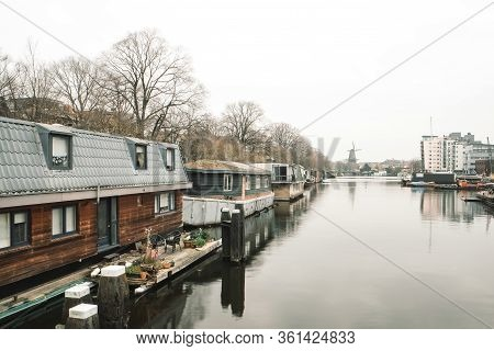 Amsterdam, Amsterdam, Netherlands - March 15 2020: Amsterdam Traditional Canals Houseboats, Architec