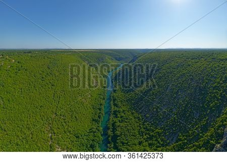 Krka River, Aerial View From The Middle Of The Canyon And Waterfall Located In Promina County At Dal