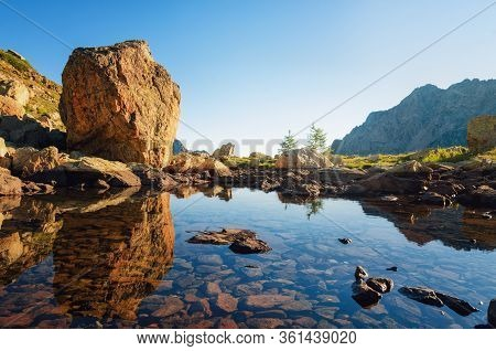 Mountain Lake Of Sant'anna, Near Vinadio (piedmont, Italy) In Maritime Alps Park, With Stone Boulder