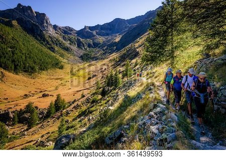 Parc Du Mercantour, France - August 12, 2017: A Group Of Hikers Walking On A Pathway Of The Parc Nat