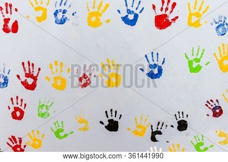 Multicolored Handprints On A Light Gray Wall. Background.