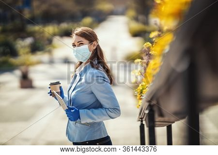 Young Business Woman With Protective Mask On Her Face And Digital Tablet In Her Hand Is Having Coffe