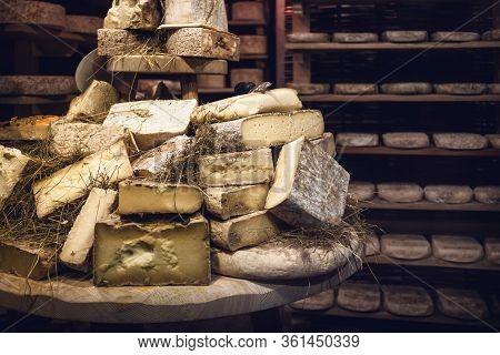 Italian Toma (hard Cheese) Seasoning In A Cold And Dark Cellar