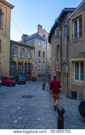 Metz, France - August 31, 2019: A Narrow Street With Old Residential Buildings In The Historical Cen