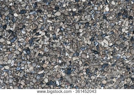 Crushed Rubble And Stones, Granite Chips Closeup. Rough Granular Surface, Gravel Texture As An Abstr