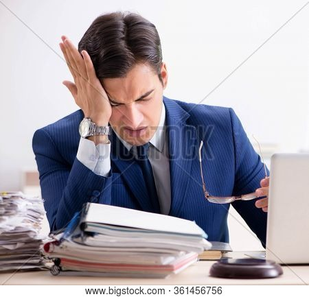 Busy man complaining about his workload