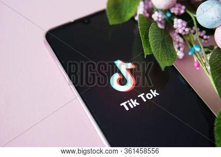 Tver, Russia-april 9, 2020, The Tik Tok Logo On The Smartphone Screen On Pink Background. Tik Tok Ic
