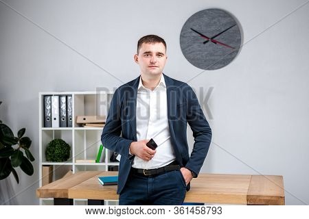 Business Man In Office. Handsome Businessman In Formal Wear Looking At Camera In Office. Overweight