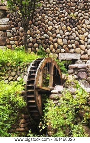 A Waterwheel In The Scenic Kenggen Stone Village In Yunhe County, Zhejiang Province China.
