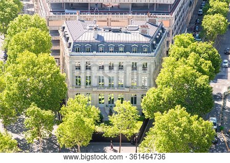 Paris. France - May 15, 2019: Old Building on Avenue des Champs Elysees next to Arc de Triomphe. View from Arc de Triomphe in Paris. France.