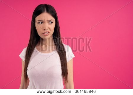 Gloomy Sad Asian Woman Has Unhappy Look, Expresses Regret And Sadness, Frowns Face,being Frustrated,