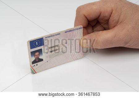 The Italian Driving License Card On A White Surface