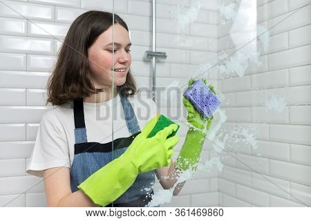 Bathroom Cleaning, Teenager Girl Washing Shower Glass With Foam And Sponges, Closeup Of Females Hand