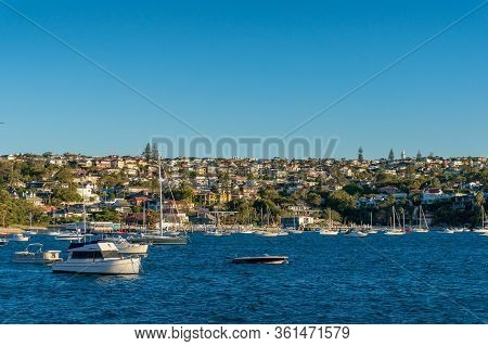 Seaside Cityscape With Waterfront Property And Yachts In The Bay. Vaucluse And Watsons Bay Suburbs O