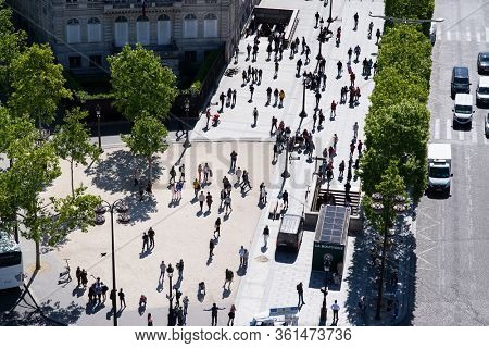 Paris. France - May 15, 2019: Crowd of Pedestrians on Avenue des Champs Elysees. View from Arc de Triomphe in Paris. France.