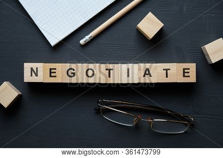 Modern Business Buzzword - Negotiate. Top View On Wooden Table With Blocks. Top View. Close Up.