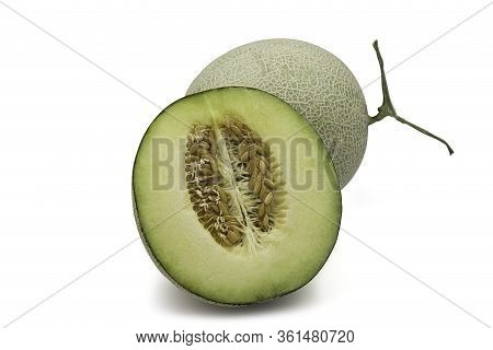 Organic Japanese Honeydew Melon And A Half On White Isolated Background With Clipping Path. Ripe Gre