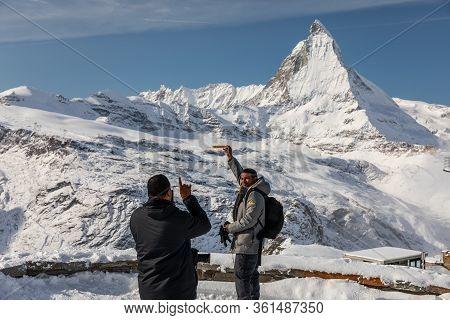 Gornergrat, Zermatt, Switzerland - November 12, 2019: Tourists Taking Photo Of Toblerone Swiss Choco