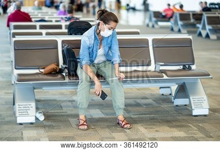 Traveler With Mask Stuck In Airport No Able To Return Home Country Due To Covid-19 Border Closures.